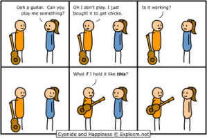 Holding-a-guitar-is-like-turning-an-on-off-switch-for-getting-laid